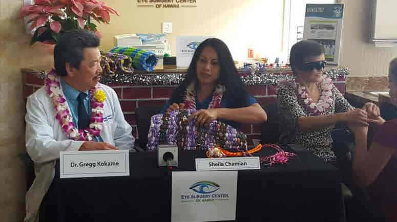 Dr. Gregg Kokame, left, of the Retina Consultants of Hawaii, Sheila Chamain, research director, center, and the patient at right.